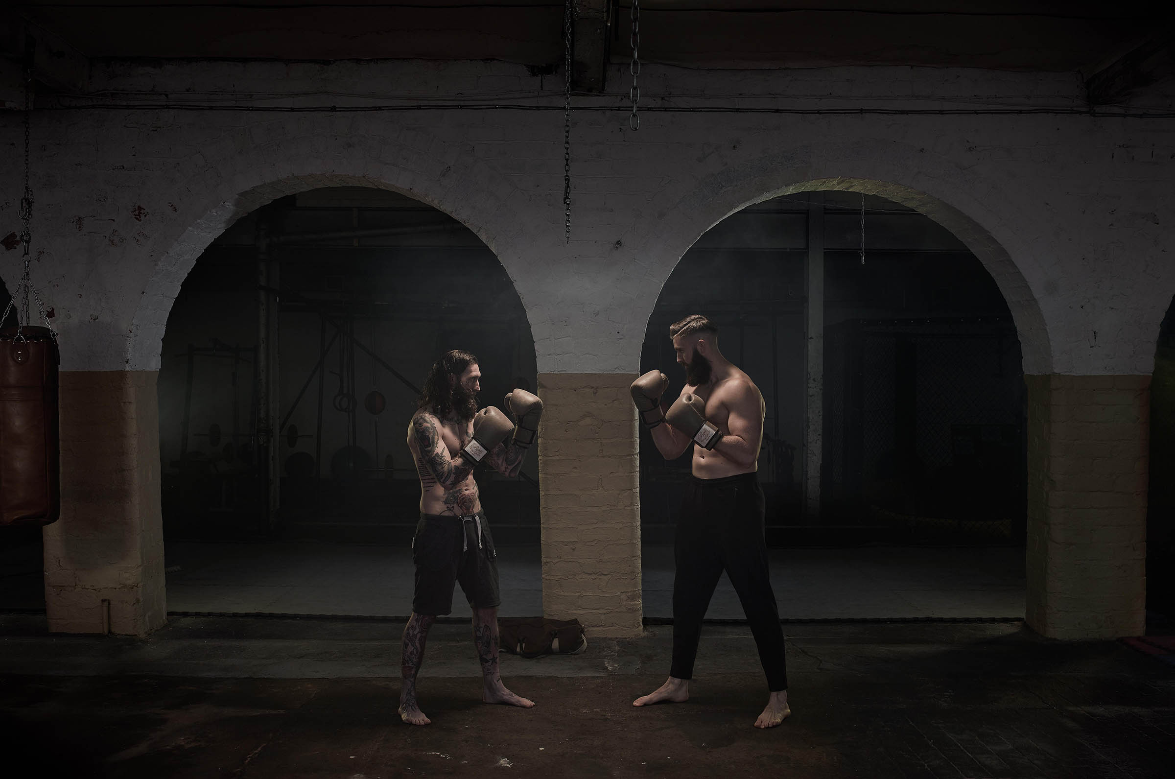 Two MMA Fighters Squaring off Wearing Traditional Combat Boxing Gloves