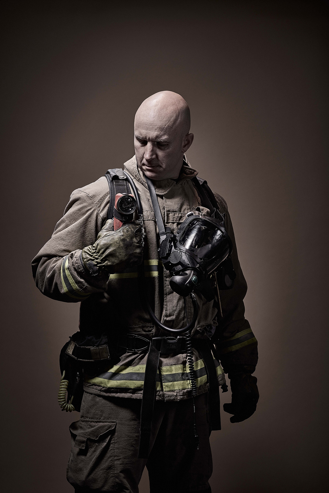 Gritty Firemen with Firefighting Equipment